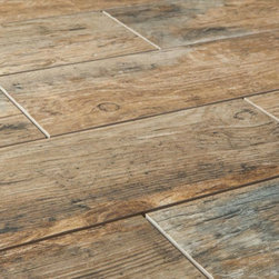 Cabot Porcelain Tile Redwood Series, Natural - These are not hardwood floors. No, these are something similar but completely different. They're tile. Tile that looks just like hardwood but is practically indestructible and very affordable.