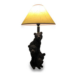 Zeckos - Three Stacked Black Bear Cubs Table Lamp with Leather Look Shade - These cuddly black bear cubs are stacked 3 high, like precocious cubs will do, to brighten your woodsy cabin, hunting lodge or home in naturally whimsical style. These furry looking fellows prove their penchant for climbing in cast resin with a lifelike hand-painted finish that shows off the amazing detail; from glossy noses to the individual hairs of their fur. This 24 inch high, 7 inch long, 7.5 inch wide (61 x 18 x 19 cm) sculptural lamp includes a 6.5 inch high, 13 inch diameter (17 x 33 cm) leather look shade, and uses 1 standard size 40 Watt maximum bulb (not included) that easily turns on or off via an in-line thumbwheel switch on the 50 inch long black cord. Great as a gift for a black bear, hunting or nature fan, this lamp is sure to receive rave reviews