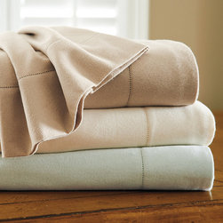 "Frontgate - Haven Flannel Sheet Set - Brushed on both sides for added softness. Preshrunk through a process called sanforization. Woven of 90% combed cotton, 5% wool and 5% silk. Set includes flat sheet, fitted sheet and two pillowcases. Fitted sheet fits mattresses up to 16"" deep. Warm and cozy for cool nights, our flannel sheets are woven of 90% cotton with a touch of silk and wool for added breathability and a luxurious drape. Tightly woven and brushed on each side for supreme softness, these sheets promise to keep the chill away. Hemstitch detail on flat sheet and pillowcase.. .  .  . . Hemstitch detail on flat sheet and pillowcase. Extra pillowcases available. Machine wash and dry. Monogram available . In a versatile palette of Ivory, Mineral and Sandstone. Made in Portugal."