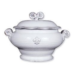 Fleur de Lis Soup Tureen - 3 Qt - A truly magnificent piece of thrown ceramic, the Fleur de Lis Soup Tureen takes advantage of this traditional material's natural heat retention to offer practical serving in a grand style reminiscent of the elite countryside manor. A lightly scalloped lid crowned by a double beaded volute knob which coordinates to the handles on the footed tureen give grace to this detailed serving piece.