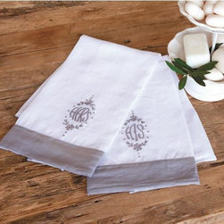 """His and Hers Hand Towel Set - Perfect for newlyweds, these bathroom hand towels combine a luxurious linen construction with feminine accents. Each of the white cloths feature gray """"His"""" and """"Hers"""" embroidery with solid gray trim for classic appeal. Made from 100% linen. Machine washable."""