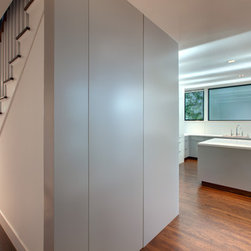 Hidden Doors - Serene and sophisticated, our hidden doors complete your modern space with their invisible looks. We carry an amazing collection of designs that beautifully match any space where a modern look is desired. Our doors have minimal decoration. We use stainless steel strips and glass to design a unique door for your dazzling chambers.