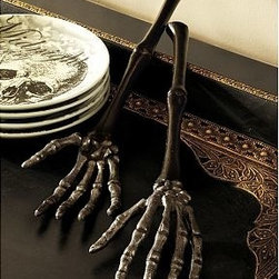 "Skeleton Hand Serving Set, Bronze finish - Add a chilling touch to your table with these skeletal serving utensils. They're artfully crafted with sculptural details for a realistic look that's deliciously frightening. 13.5"" long x 3.5"" wide Cast aluminum with an antique-nickel finish."