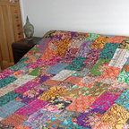 Multi Colour Kantha Quilt - Inject some colour to your room with this stunning patchwork bedspread/throw.  Made with brightly coloured fabrics this quilt has then been double stitched by hand in the kantha style to create an extraordinary texture and appearance. The quilt has been lined with a coordinating material. All of our striking kantha quilts are handcrafted which means each one is unique.