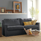 Henry Slipcovered Sofa - With its casual comfort and classic silhouette, this eco-savvy sofa is an adaptable, clean-lined crowd pleaser, and the slipcovers only add to its flexibility. They can be removed, which makes cleaning simple, and they're available in different colors, so changing the sofa's look is easy. Like every piece in the Henry Collection, this sofa is assembled at west elm's own facility in the USA, where it's built using sustainably harvested wood certified by the Forestry Stewardship Council (FSC) and finished with a bevy of recycled materials.