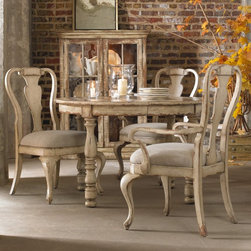 Hooker Furniture - Wakefield Splat Back Dining Side Chairs - Set of 2 Multicolor - HOOK1735 - Shop for Dining Chairs from Hayneedle.com! Light monochromatic and classic the Wakefield Splat Back Dining Side Chairs - Set of 2bring an original look to your dining room. Traditional design in a distressed off-white finish makes for country charm that brightens up your dining space. The soft upholstered seat and arms provide ultimate comfort you'll love. Settle in to dinner with style and coziness.Not available for sale in or delivery to the state of California.About Hooker Furniture CorporationFor 83 years Hooker Furniture Corporation has produced high-quality innovative home furnishings that seamlessly combine function and elegance. Today Hooker is one of the nation's premier manufacturers and importers of furniture and seeks to enrich the lives of customers with beautiful trouble-free home furnishings. The Martinsville Virginia based company specializes in lifestyle driven furnishings like entertainment centers home office furniture accent tables and chairs.Construction of Hooker FurnitureHooker Furniture chooses solid woods and select wood veneers over wood frames to construct their high-quality pieces. By using wood veneer pieces can be given a decorative look that can't be achieved with the use of solid wood alone. The veneers add beautiful accents of color and design to the pieces and are placed over engineered wood product for strength. All Hooker wood veneers are made from renewable resources and are located primarily on the flat surfaces of the furniture such as the case tops and sides.Each Hooker furniture piece is finished using up to 30 different steps including 13 steps of hand-sanding and accenting. Physical distressing is done by hand. Pieces receive two to three coats of solid lacquer to create extra depth and add durability to the finish. Each case frame is assembled using strong mortise-and-tenon joints which are then reinforced by mechanical fasteners 