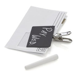 Clip Amo Blackboard - Originally made from cookware handle fasteners, industrial-style, stainless-steel clip is affixed with a chalkboard slate to label and secure office papers and household notes.