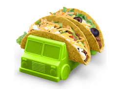 Fred and Friends - Taco Truck - You're in luck! There's a new food truck in town, and it's parked right next to YOU! Drive Fred's Taco Truck up to your messiest eater and marvel at how it serves the goods. These washable food-safe plastic trucks are a playful addition to your table. You get two assorted trucks in each set - one salsa red and one guacomole green - packaged in a full-color giftbox.