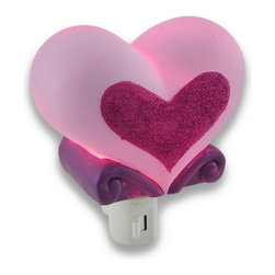Cute Pink Glitter Heart Children`s Night Light Nite Lite - This adorably cute pink heart night light adds a pretty accent to your little girl`s room while casting a comforting glow in the nighttime hours. Made of cold cast resin, it features a sparkly glitter heart accent to delight your little princess, and it measures 4 1/4 inches long (11 cm), 3 1/4 inches tall (8 cm), and 2 1/2 inches deep (6 cm). It has a 360 degree swivel plug to accommodate any outlet, and it uses a 7 watt (max) type C night light style bulb (included). The light has an on/off switch on the front, and is recommended for children ages 6 and up.