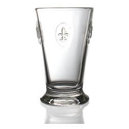 Fluer De Lys Highball - Dramatic and formal in its design, but with the substantial appeal of glassware which can be used for casual gatherings and elegant parties alike, the Fleur de Lys Highball is an attractive clear drinking glass in a usefully versatile shape: a tapered double-height tumbler with handsome heraldic symbols indicated around the upper half of its walls. Use it for transitional convenience with an old-world impression.