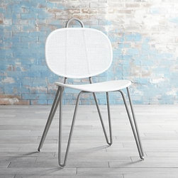 "Mallorca Grey and White Metal Side Chair - Paola Navone's unique and unexpected furnishings are simple, elegant and immediately familiar, with a livable look that blends with any style. The graceful Mallorca collection is dedicated to fluid forms and casual, natural materials. Grey metal tube curves up and down into one continuous frame, supporting the back with its flexible, spring-like construction and looping at the top as a handle. Exclusive ""+"" and ""0"" motif patterns seat and back in a fresh take on mesh in pure white."