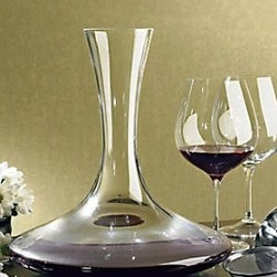 Wine Enthusiast Vivid Wine Decanter - This non-lead crystal wine decanter by The Wine Enthusiast is lightweight for easy pouring. Specially shaped to provide maximum aeration for both young and mature wines. Glass decanter is hand-made in Europe. 9-1/4 H and holds up to 47oz of wine, gift boxed.