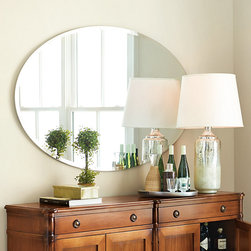 Ballard Designs - Mercier Oval Mirror - Also great as a dressing mirror. Large enough for double sink vanity. The graceful oval shape and grand scale of our Mercier Mirror is accentuated with a generous bevel without the visual weight of a frame. Wired to hang either way, so it works beautifully above a sofa or hung vertically to add a sense of height.Mercier Oval Mirror features: . .