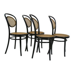 """Pre-owned Michael Thonet A6658 Bentwood Side Chair - S/4 - These Michael Thonet designed bentwood side chairs are classics! The bentwood side chairs have the additional elegance of hand-woven cane in the seat and back. These chair's classic elegance makes them a great addition to a home, restaurant or office.    Original European Thonet factories in Radomsko Poland, and Brno, Czech Republic, using historic molds and techniques, manufactured these pieces. Remarkably few changes have been necessary over the last 150 years. The factories still follow the 18th century production methods developed by Michael Thonet to produce historically accurate, handsome, and sturdy bentwood chairs, stools, tables, and accessories. Cane seats are hand-tied, and wood laths steamed and bent into curved jigs then dried, sanded, and finally stained and varnished before being assembled.     They were featured in House Beautiful's design trend section: """"Everywhere We Look.""""    Check the seller's other listings for a Thonet armchair in the same style.    Seat height 18 1/4""""   Seat diameter 16 1/4"""""""