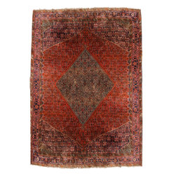 A Vintage Persian Wool Rug - A Vintage Persian Wool Rug, centered with a diamond medallion and woven in various vivide tones of red and blue along with a spectrum of pastel tones