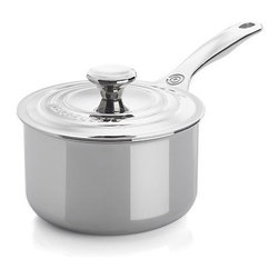 """Le Creuset® Signature Stainless Steel 2 qt. Saucepan with Lid - Le Creuset puts their signature on this professional-quality, triple-layer cookware, an expression of their passion for quality and engineering excellence. Premium stainless steel with a beautiful luster sandwiches a """"total"""" aluminum core—from the base all the way up to the drip-free, precision pour rims—for even heat throughout. A special magnetic steel makes it perfect for all cooktops, including induction. Thoughtful design details include laser-etched interior capacity markings and a hollow, ergonomic stainless handle that stays cool to the touch. Tight-fitting lid with the signature triple ring design, oven-safe knob and stable, flat rim locks in flavor and moisture. An internal self-sealing flange locks in moisture and flavor, while a relief vent helps release excess pressure and steam to prevent boiling over. All pieces are versatile enough to go from the stovetop to the oven."""