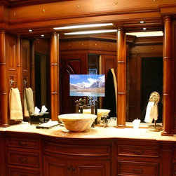 Seura Television Mirrors - These televisions are built right into your vanity mirror, so there are several benefits.  One, you don't need any additional space or mounting method.  Two, you can easily watch it while brushing your teeth or shaving.  Three, there are no visible wires.  It's sleek and adds a wow factor to your bathroom!