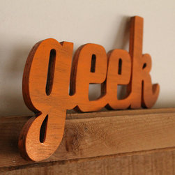 """Geek Wood Sign by Banished - I embrace all things nerdy and am totally fine with the label """"geek,"""" but you may want to make sure your kids are confident before putting this in their room."""