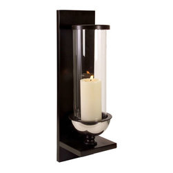 Silver Metal and Glass Wall Sconce - Modern silver metal and glass wall sconce. Holds pillar candle, glass cylinder is tall and slender, clean lines in the wall mount complete a modern look