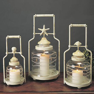 Frosted Globe Shell Lanterns - These lanterns have a ton of character. I love the metal design and handle with the shells popping up on top. Since it comes in three sizes with different shell motifs it would make a great grouping on a large outdoor dining table or scatter them around side tables to tie the room together.