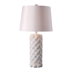None - 'Augustine' Shell Textured Antique White Table Lamp - Overlapping shells create the base of this antique white table lamp, reminiscent of a sea-side getaway. This nautical inspired piece is topped off with a cream white drum shade.