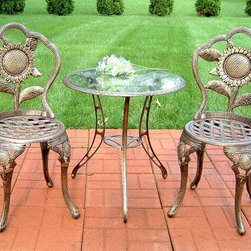 Oakland Living - Three Pc Glass-Top Bistro Set w Sunflower Mot - Set includes 1 table and 2 chairs. Tempered glass table top. Umbrella opening on table. High-grade polyester powder coat finish. Brass and stainless steel hardware ensures sturdiness, durability and security for years. Long lasting, beautiful finish maintains appearance for years to come. Minimal maintenance. Electrostatic application of the powder coat insures a smooth, even finish. Quick and easy assembly assured with step-by-step assembly instructions included. Double QC quality program in which each piece is assembled prior to being unassembled and packaged assures that all parts are present and that the product will assemble easily. Rust-free cast aluminum construction. Antique Bronze finish. Table: 26.5 in. W x 26.5 in. D x 28 in. H. Chair: 18 in. W x 36.5 in. H