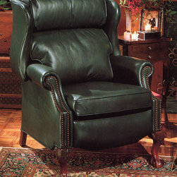 Leather Recliner Chair - This green leather recliner is a traditional favorite.  The double pillow back is recognized with traditional furniture.  The ball in claw hand carved solid wooden feet can be finished in your choice of wood stain.