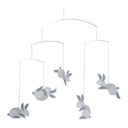 Flensted Mobiles - Circular Bunnies Mobile - Hop to it! This mobile is a study in geometry and contrasts — each frolicking bunny is cut from a circle. The contrast between light and dark makes it a perfect gift for newborns, but you could also use it as a festive reminder of spring.