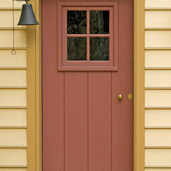Sheathed Door with Small Sash - This is a traditional sheathed door with a four light window sash.  The door is fitted into a door frame with stone threshold.