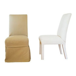 "Pre-owned Quatrine Slipcovered Parsons Dining Chairs - Just Reduced!    This pair of slipcovered parsons style dining chairs are from Quatrine in San Francisco. The chairs come with removable and machine washable taupe matelasse slipcovers that show some signs of wear.  The chair forms are covered in muslin and are in great condition.  These chairs are extremely comfortable and well constructed. Make your own new slipcovers or order new ones from Quatrine.    Quatrine was founded in1989 and has become the industry standard for slipcovered and upholstered furniture.  Known for perfecting the washable slipcover, you can always order additional washable slipcovers for your Quatrine furniture at any time in the future.     Seat Height is 19""."