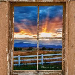 Picture Window Frame Fine Art Photography - Beams of sunlight coming through the clouds above the Rocky Mountains with a scenic country view with white ranch fence and brown rustic pealing barn portrait picture window frame view.