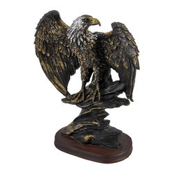 Bronze Finished Perched American Bald Eagle Statue Hand Painted Accents - This beautiful cold cast resin perched American Bald Eagle statue makes a great addition to the home of any patriotic American. The statue measures 10 inches tall, 7 1/4 inches wide and 4 1/4 inches deep. It has a wonderful bronzed finish that gives it the look of metal, and has hand-painted accents to show off the incredible detail. It`s a must have for nature lovers.