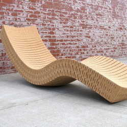 Cortiça Chaise Longue - This chaise caught my attention. It's made of 100 percent recycled cork and rocks side to side and front to back. The only thing that could make it better is if it were mine! I love it.