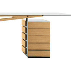 Cavour - There's something aerodynamic about the way this designer has assembled the pieces of this desk. The right side is weighed down by your files and important papers, while the left side takes a usual desk shape and completely reimagines it.