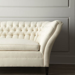 """Old Hickory Tannery - Old Hickory Tannery """"Ellsworth"""" Neutral Tufted-Curve Sofa - Exclusively ours. Soft, natural cotton upholstery gets a dose of drama from tufting along the back and sides. Handcrafted of European beech with a coffee-bean finish. Upholstery is biodegradable cotton. 84""""W x 33""""D x 35""""T. USA made of Italian mat..."""