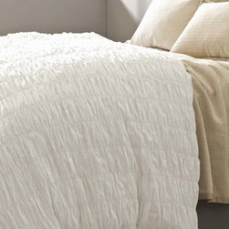 Smocked White Duvet Cover - Solid white bedding is more interesting and transitional duvet styling is more textural with the Smocked White Duvet Cover in pure cotton.  Vertical bands of stitching anchor columns of puckered pleats in the fabric, which fall somewhat haphazardly in adjacent rows to give an organic feel to the clean freshness of the snow-white duvet.  Easily lend interest to a bed with this cotton cover.