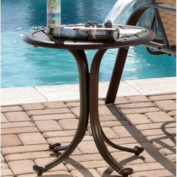 Hospitality Rattan - Panama Jack Island Breeze Patio End Table with Slatted Aluminum Top - Espresso F - Shop for Tables from Hayneedle.com! The Panama Jack Island Breeze Patio End Table with Slatted Aluminum Top - Espresso Finish is just what you need to keep snacks and beverages handy or magazine within arm's reach. Showcasing graceful lines and subtle curves for a look that's both upscale and contemporary this end table makes a great addition to any patio or poolside. Boasting a tubular extruded aluminum frame in a unique powder coated espresso finish that will not rust this weather-resistant table features an attractive no-glass slatted aluminum top that prevents water accumulation.About Hospitality RattanHospitality Rattan has been a leading manufacturer and distributor of contract quality rattan wicker and bamboo furnishings since 2000. The company's product lines have become dominant in the Casual Rattan Wicker and Outdoor Markets because of their quality construction variety and attractive design. Designed for buyers who appreciate upscale furniture with a tropical feel Hospitality Rattan offers a range of indoor and outdoor collections featuring all-aluminum frames woven with Viro or Rehau synthetic wicker fiber that will not fade or crack when subjected to the elements. Hospitality Rattan furniture is manufactured to hospitality specifications and quality standards which exceed the standards for residential use.Hospitality Rattan's Environmental CommitmentHospitality Rattan is continually looking for ways to limit their impact on the environment and is always trying to use the most environmentally friendly manufacturing techniques and materials possible. The company manufactures the highest quality furniture following sound and responsible environmental policies with minimal impact on natural resources. Hospitality Rattan is also committed to achieving environmental best practices throughout its activity whenever this is practical and takes responsibility f