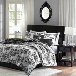 Home Essence - Home Essence Leonora 5 Piece Comforter Set - The Leonora collection is updated and versatile for any look you want for your bedroom. A beautiful scroll, floral motif is printed on the front and back of the comforter and sham in contrasting black and white colors. The comforter and sham is fully reversible for you to decorate your bed. The comforter set includes comforter, sham and two decorative pillows. Comforter and sham: micro fiber 85gsm, 75gsm microfiber back, knife edge, 6oz poly fill. Pillow: poly cover with poly fill