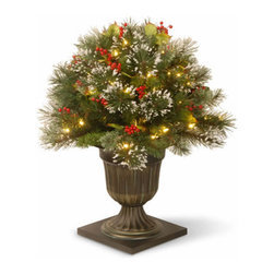 26 In. Wintry Pine Porch Christmas Bush with 50 Clear Lights - Measures 26 inches tall with 22 inch diameter. Indoor or covered outdoor use. Pre-lit with 50 UL listed, pre-strung Clear lights. Tip count: 106. Decorative urn base. Trimmed with red berries and pine cones. Light string features BULB-LOCK to keep bulbs from falling out. If one bulb burns out the others remain lit. Includes spare bulbs and fuses. Fire-resistant and non-allergenic. Packed in reusable storage carton.