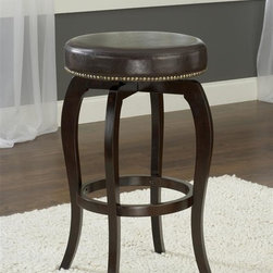 Hillsdale Furniture - Backless Swivel Stool - Brown Vinyl (26 in. C - Choose Size: 26 in. Counter HeightSolid hardwood360 degree swivelCappuccino finishBlack or brown vinyl seat. 17 in. W x 17 in. D x 25 in. H (15 lbs.)Effortless and uncomplicated, the Wilmington is a stool for any style. Constructed of solid hardwood and featuring a 360 degree swivel seat, the backless Wilmington has a lovely cappuccino-hued finish and comes with either a black or brown vinyl seat covering. The Wilmington is Some assembly required.
