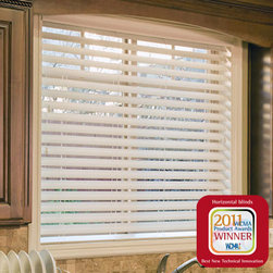 """Norman Faux Wood Blinds - Ultimate 2 1/2 Faux Wood Blinds. Whites and off-white. - Ultimate 2 1/2 Faux Wood Blinds - Buy with Confidence, Get Free Samples Today!The Ultimate 2 1/2"""" Faux Wood Blinds from Norman offers much more privacy than the average faux wood blind when closed, at a slat size that keeps a better view outside when open. The non-slip, patented SmartPrivacy slats create perfect privacy due to tighter closure than most blinds. This is due to SmartPrivacy's design, giving the slats smaller holes, which are concealed when the blinds are closed. Comes standard with a 3"""" designer valance and invisible clips.  Install Time: 7-10 minutesWe Recommend:"""