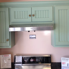 Simple stove vent with cabinet above.  Cabinets are not that interesting but lay