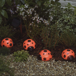 Grandin Road - Ladybugs Set of Four Solar Lights - Solar lights automatically illuminates during darkness. One red LED per ladybug. Up to 8 hours of light each night when fully charged. 4 ladybug lights per strand. Replaceable, rechargeable Ni-MH battery included. Our Ladybug Solar Light Set is whimsical way to add color and light around your shrubs and flowerbeds. These ladybug lights are powered by a separate solar panel, allowing them to be placed in shady areas, perfect for nesting around growing plants.. . . . . No wiring, simply install and enjoy.