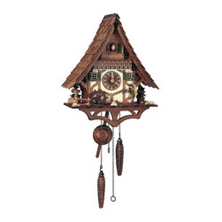 Schneider Cuckoo Clocks - Quartz Black Forest House Cuckoo Clock in Antique Finish - Two metal weights. Electronic light sensor for automatic shut-off. Manual shut-off switch on left side of clock. Push button to set strike and time on left side of clock. Twelve different melodies. Individual hand laid wooden shingles. Cuckoo clock with reliable quartz movement, carving, clock case, bird and dial are hand carved wood. Wooden cuckoo, dial with roman numerals and hands. Moving clock peddler and mill wheel move at the full hour. Dual melody with changing tune plays at every full hour. Made from wood. Antique finish. Made in Germany. 11.8 in. W x 6.7 in. D x 13.4 in. H (6.6 lbs.). Care Instructions