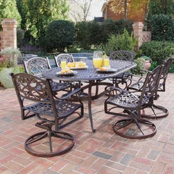 Home Styles Biscayne Bronze Swivel Patio Dining Set - Seats 6 - Al fresco dining will become to become a regular guilty pleasure when you choose the Home Styles Biscayne Bronze Swivel Patio Dining Set - Seats 6. A stylish, yet functional addition to your patio or sunroom, this set, which includes a 72-inch oval dining table and six swivel dining chairs, is as fetching as it is functional. With an attractively patterned tabletop that allows water to pass through freely, the table is large enough for six place settings and has an umbrella hole that will support a standard patio umbrella for some much-needed shade on hot days. The stylish, scroll-accented swivel chairs are not only comfortable, they will also have you lingering at the table longer than usual with their soothing rocking motion.Constructed of sturdy cast aluminum, each piece sports a powder-coat antiqued Rust Bronze finish sealed with a clear coat to keep it looking like new for years to come. A cost-effective alternative to cast iron, this outdoor dining set gives you the beauty of ornately designed pieces without the high cost. Adjustable nylon glides prevent damage to your floor and provide stability on uneven surfaces.Dimensions:Table dimensions: 42W x 72D x 28.5H inchesSwivel chair dimensions: 24.4W x 22.05D x 33.46H inchesSeat height: 16 inchesAbout Home StylesHome Styles is a manufacturer and distributor of RTA (ready to assemble) furniture perfectly suited to today's lifestyles. Blending attractive design with modern functionality, their furniture collections span many styles from timeless traditional to cutting-edge contemporary. The great difference between Home Styles and many other RTA furniture manufacturers is that Home Styles pieces feature hardwood construction and quality hardware that stand up to years of use. When shopping for convenient, durable items for the home, look to Home Styles. You'll appreciate the value.