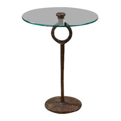 Uttermost Diogo Glass Accent Table - A clear, tempered glass top showcases the hand-wrought artistry of this heavily oxidized, cast iron side table. A clear, tempered glass top showcases the hand-wrought artistry of this heavily oxidized, cast iron side table.