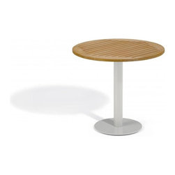 Oxford Garden - Travira 32 Bistro Table, Tekwood Natural - The Travira 32 Bistro is a stylish table that features a classic, yet modern round top and base. The table top is available in Teak, Tekwood (Natural or Vintage) or Alstone, complementing the bold gray of the powder-coated aluminum. The Travira bistro is perfect for a balcony, cafe or other outdoor dining environment. Tekwood: Table top made from Tekwood, a wood-alternative developed from polystyrene. Tekwood provides the look of wood without the weathering process or maintenance.