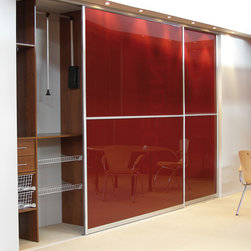 Sliding Doors - 8' Reach in Closet with aluminum doors that contain red glass inserts.