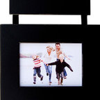 MyBarnwoodFrames - 5x7 Three Opening Collage Picture Frame Set PLP Three Black Frames on Ribbon - Collage  Picture  Frame  Set-  Three  5x7  Basic  Black  Frames  on  Ribbon          Your  nursery,  child's  bedroom,  or  family  room  deserves  a  photo  display  this  adorable!  Our  multi-opening  frames,  shown  here  in  basic  black  make  a  unique  wall  display  or  the  perfect  gift.  Three  individual  wood  frames  are  connected  by  a  hanging  ribbon.  Just  drape  the  ribbon  over  a  decorative  wall  hook  or  coat  hook.          A  unique  collage  frame  that  allows  you  to  display  three  5x7  photos  at  once,  each  with  a  different  orientation.  This  unique  configuration  accommodates  two  portrait  (vertical)  and  one  landscape  (horizontal)  photo  all  in  the  same  multi  photo  grouping.  All  three  5x7  frames  are  suspended  from  a  black  hanging  ribbon.  Hand  distressed  edges.