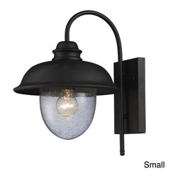 ELK LIGHTING - Streeside Cafe 1-light Matte Black Outdoor Sconce - This matte black ironwork outdoor sconce lantern provides the charm that comes at an outdoor cafe. The heavy seeded blown glass helps provide a style from an auuthentic old world.